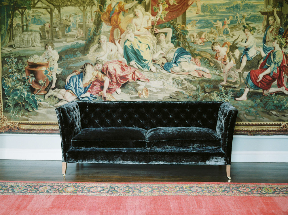 velvet couch at st giles house wedding venue
