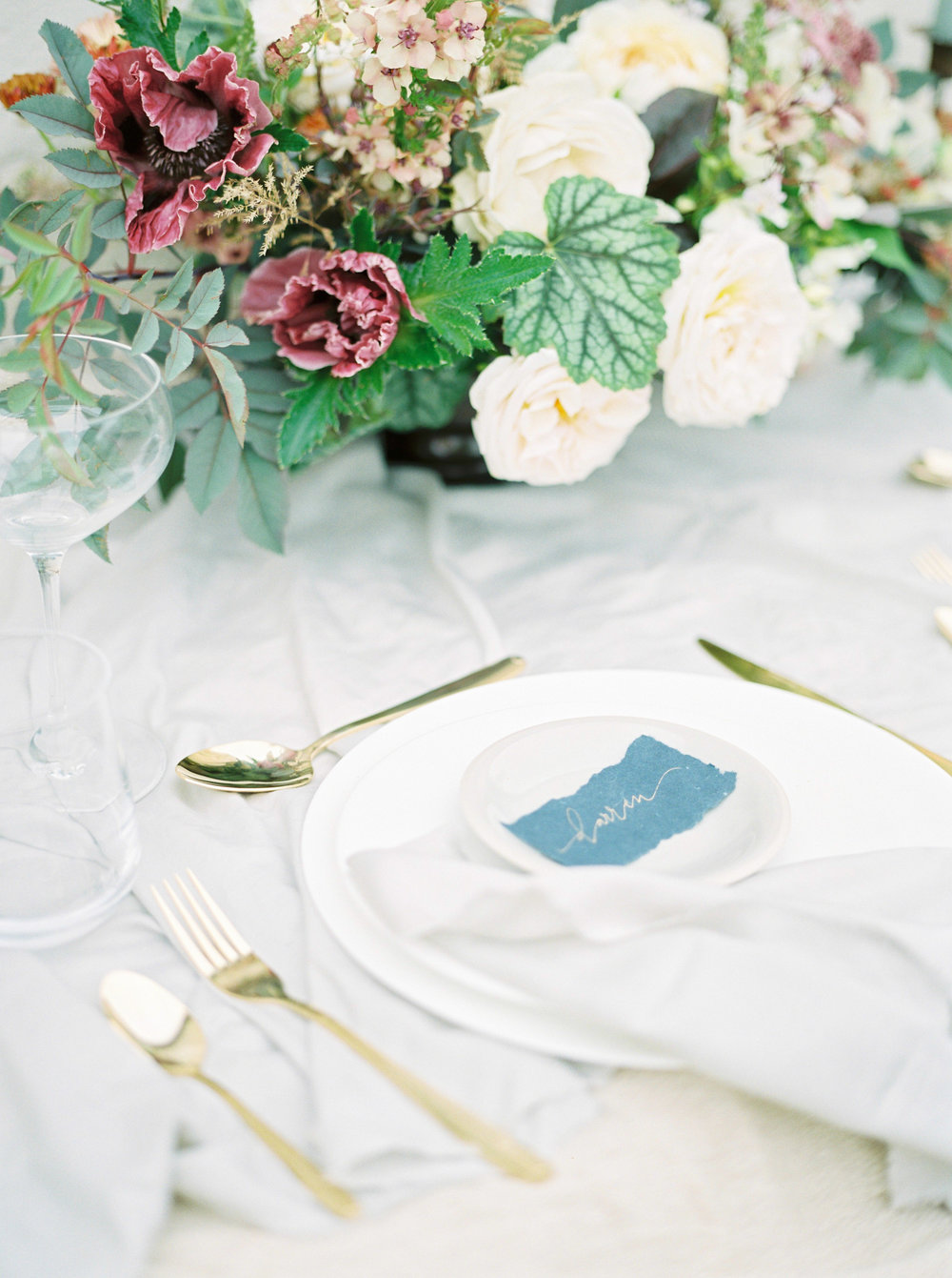 wedding table with gold cutlery by imogen xiana photography