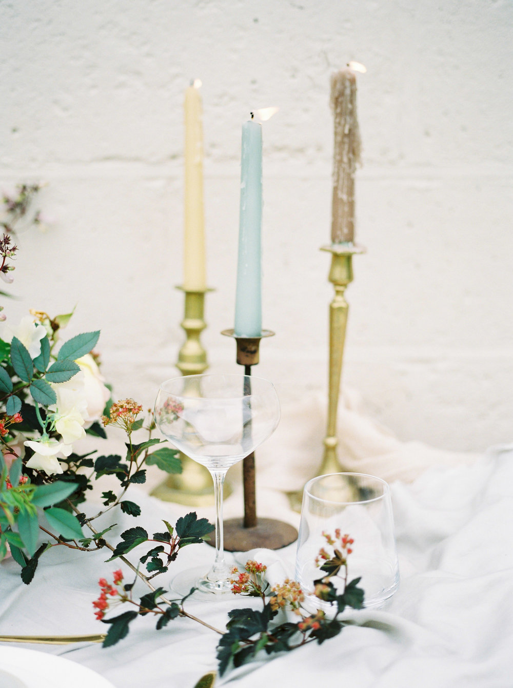 coloured wedding candles and gold candle stick holder by imogen xiana wedding photography