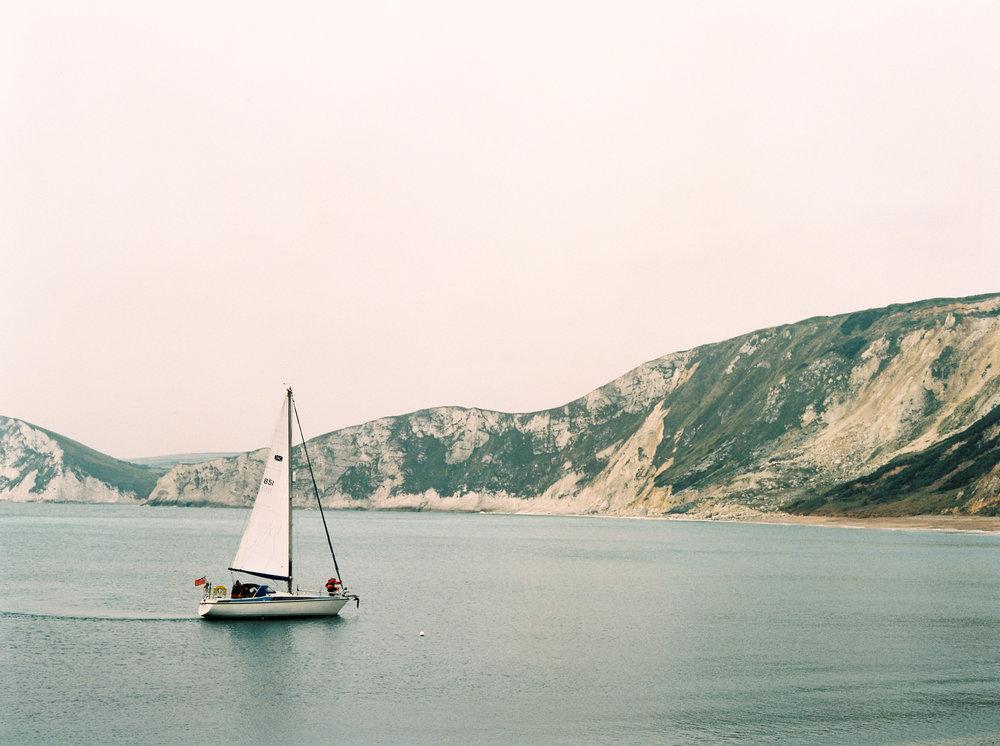 sailing boat in worbarrow bay