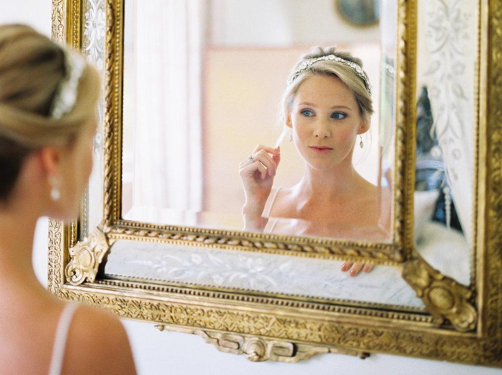 bride looking in the mirror by imogen xiana