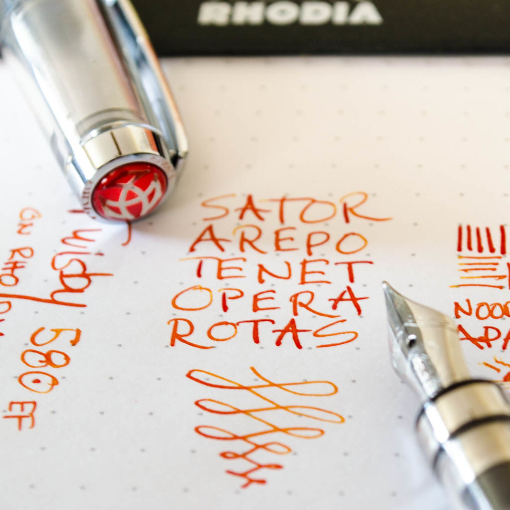 "The Sator Square inked with my TWISBI Diamond 580 in a Rhodia DotPad 5x5 80 with a Nikon D5100 18-55mm 'Kit"" lens"
