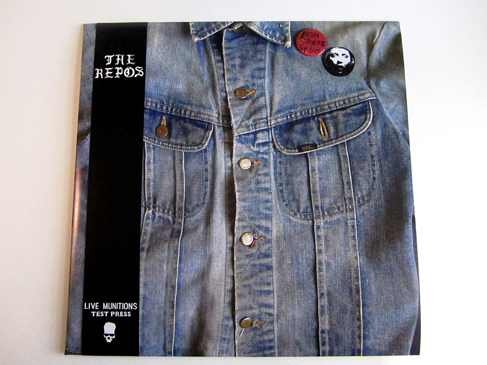 "THE REPOS ""Live Munitions"" Test Press LP featuring IRON CROSS front man Sab Grey's original denim jacket from the early 1980's. Features full color, extra heavy handmade tip-on jackets, double-sided cardstock insert, virgin LP labels, and obi strip. Edition of 25, Youth Attack, 2013."