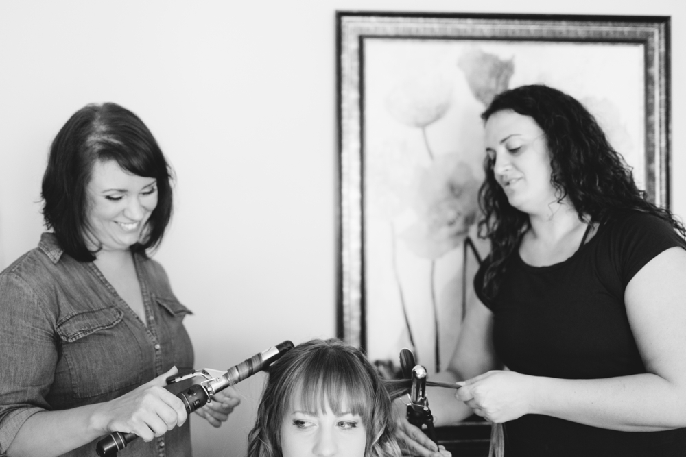 Bride getting ready with bridesmaids at the Gettysburg Battlefield B&B in Gettysburg PA, Hair by Downstreet Salon, Makeup by Texture Salon, Wedding Photographers With Love & Embers