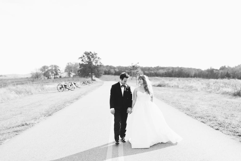 Bride & Groom portraits at Gettysburg Battlefield, Gettysburg PA, Dress: Watters, Hair: Downstreet Salon, Makeup: Texture Salon, Flowers: Splints & Daisies, Wedding Photographers With Love & Embers