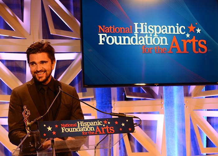 Juanes receiving the Raul Julia Award