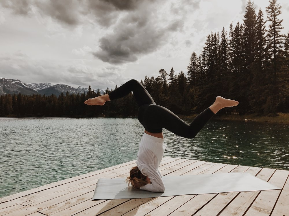Before we hit the road to travel down to Banff we stopped by this lake. It was quiet, there weren't many people around and it was the perfect spot for some mediation and yoga practice. A goal of mine for this trip and my yoga practice was to get more familiar with being upside-down. Its always made me nervous and I lacked the confidence to try. It really just took an acceptance that falling is inevitable when you are learning, its all about maintaing that acceptance while trying and growing. Photo by   Antrom Kury