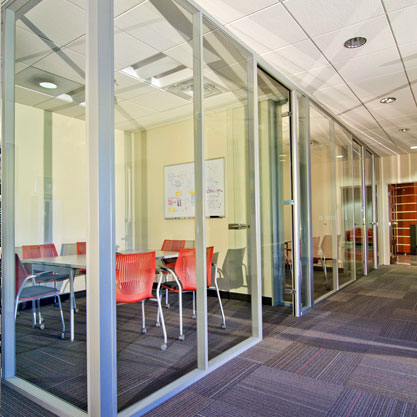 Glass partitions and doors were designed to encourage interaction and informal meetings.