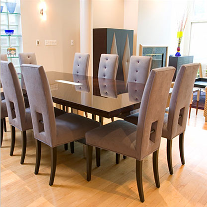 Seating for ten was placed around this custom made dining table by Brueton, with a light panel inset in the center of the table.