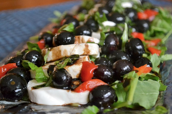 Stephanie:  I love caprese salads, and adding blueberries makes this version the perfect plate for the holiday.