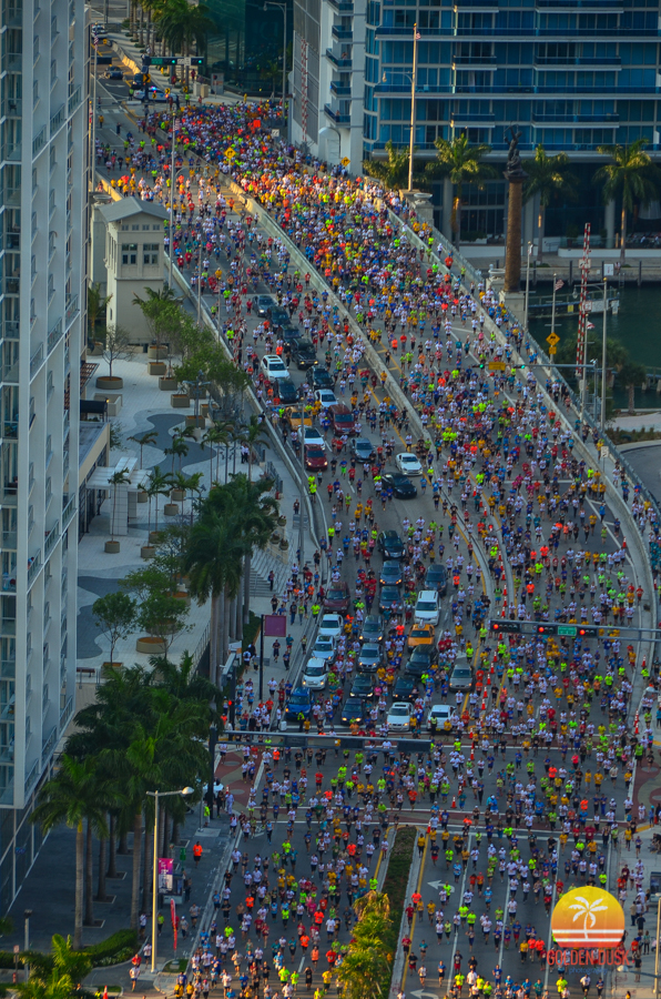 Participants race in the 2014 Mercedes-Benz Corporate run on Brickell Ave.