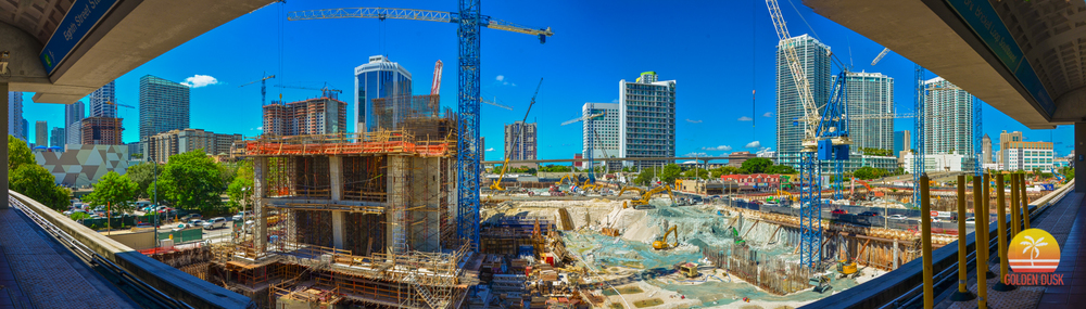October 2013  - Over a year later, Hotel East is beginning it's vertical rise. Digging is still continuing for Condo West and Condo North. NINE at Mary Brickell Village and 1100 Millecento can now be seen.