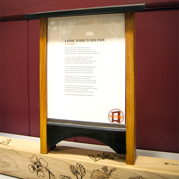 Poetry Box at the Madeleine School. The students are wood-burning native plants onto the post the box with stand on.