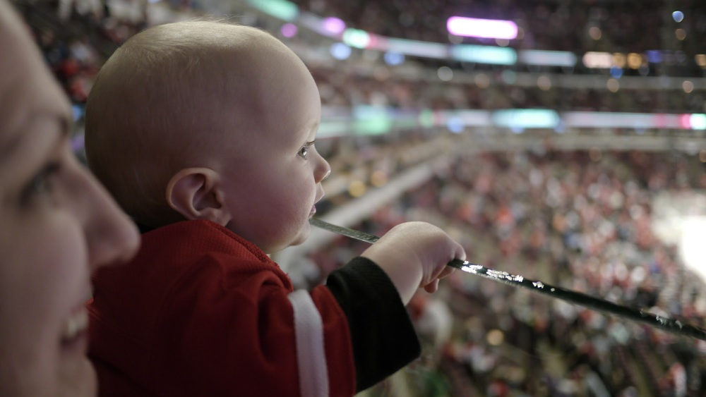 My son at his first game. (You pay for a seat to use as little of it as possible)