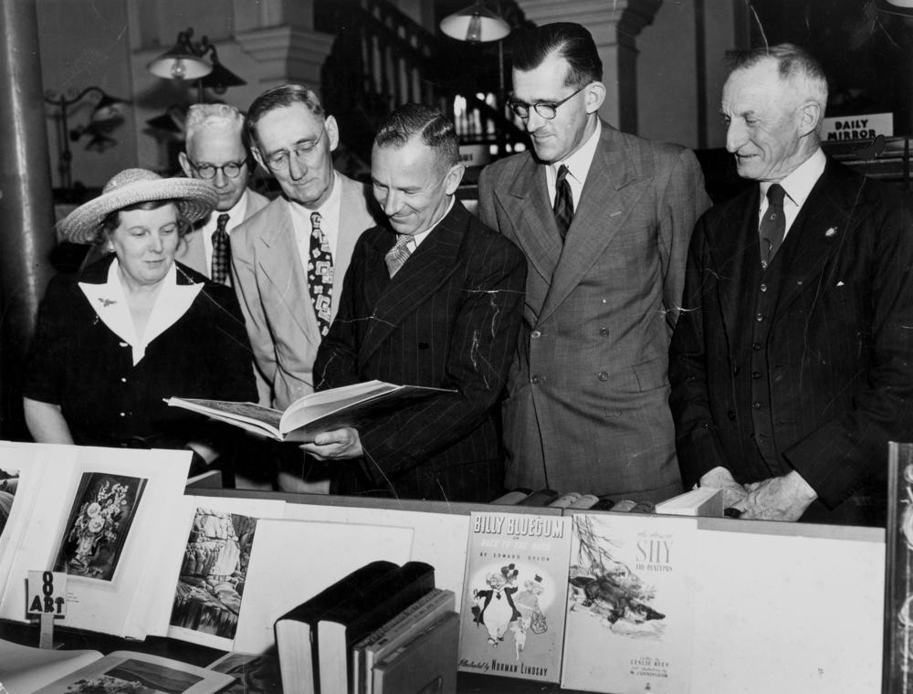 James Stapleton, State Librarian, and guests at the Book Week launch, circa 1948. State Library of Queensland Digital Image Collection. Accession number 81-3-2.