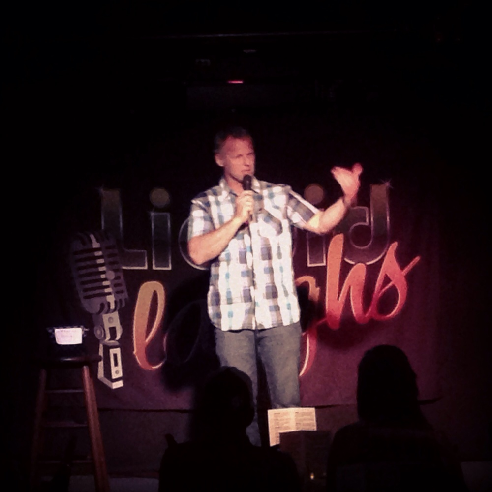 Doug on stage at Liquid Laughs