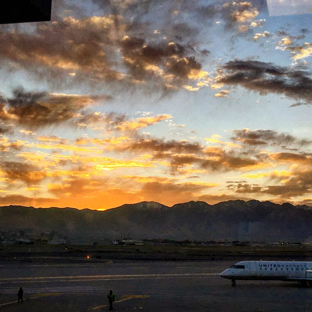 The sun rising over the mountains of the salt lake valley. With a plane in the shot because I only do sunrise photos at airports.