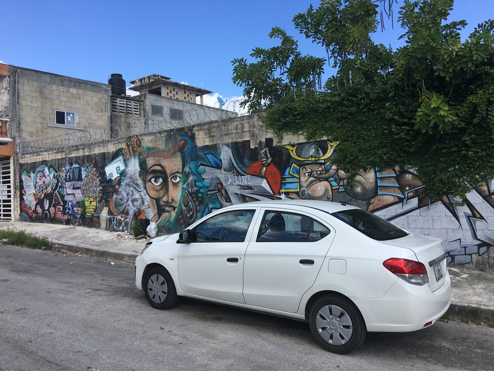 Our rental in front of some great street art
