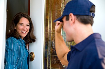 stock-photo-19583861-repairman-in-uniform-greeting-housewife.jpg