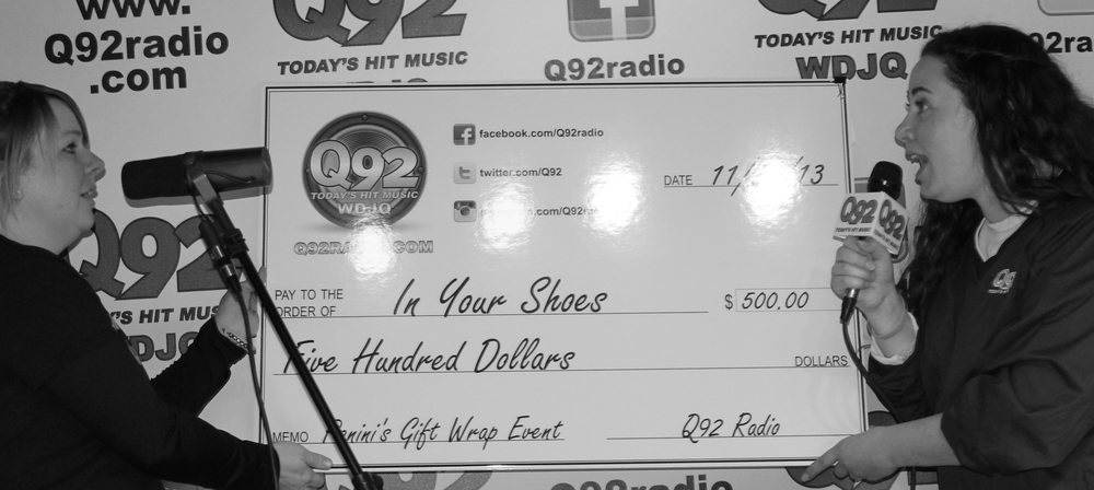 Nikolina from Q92 presenting a check for $500.00 to In Your Shoes, The Sophia Capo Memorial Foundation to support Christmas at The Ronald McDonald House, Cleveland.