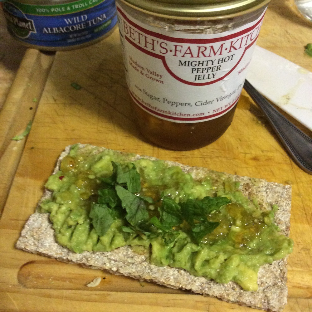 Mid-cooking snack: light rye Wasa cracker with lemon avocado, Beth's Farm Kitchen mighty hot pepper jelly & mint