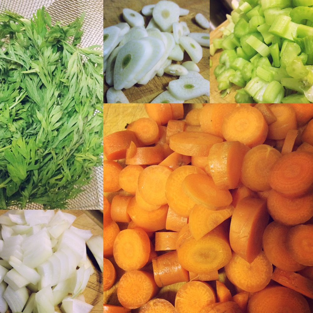 Clockwise from top left: Carrot greens, garlic, celery, carrot, onion.