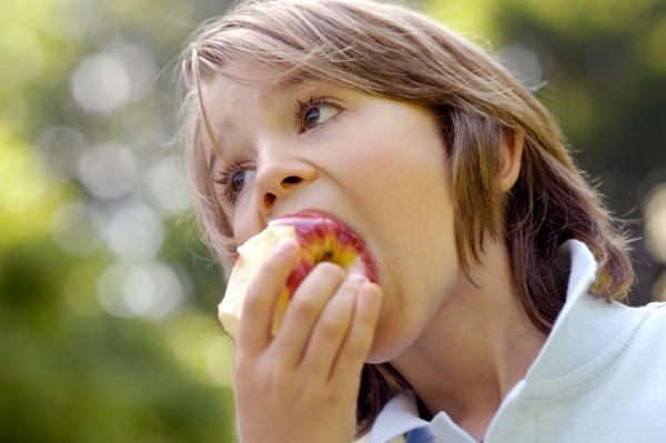 boy-eating-apple-on-the-go.jpg