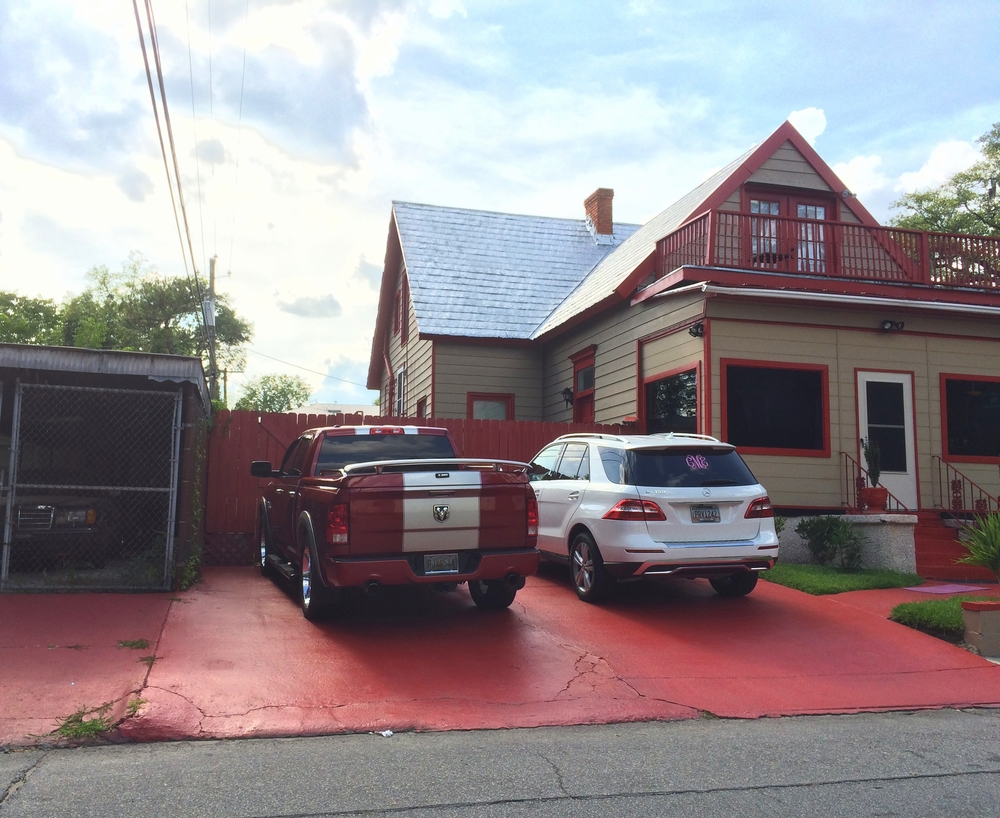 This driveway and portions of sidewalk were painted bright red on East 37th Street