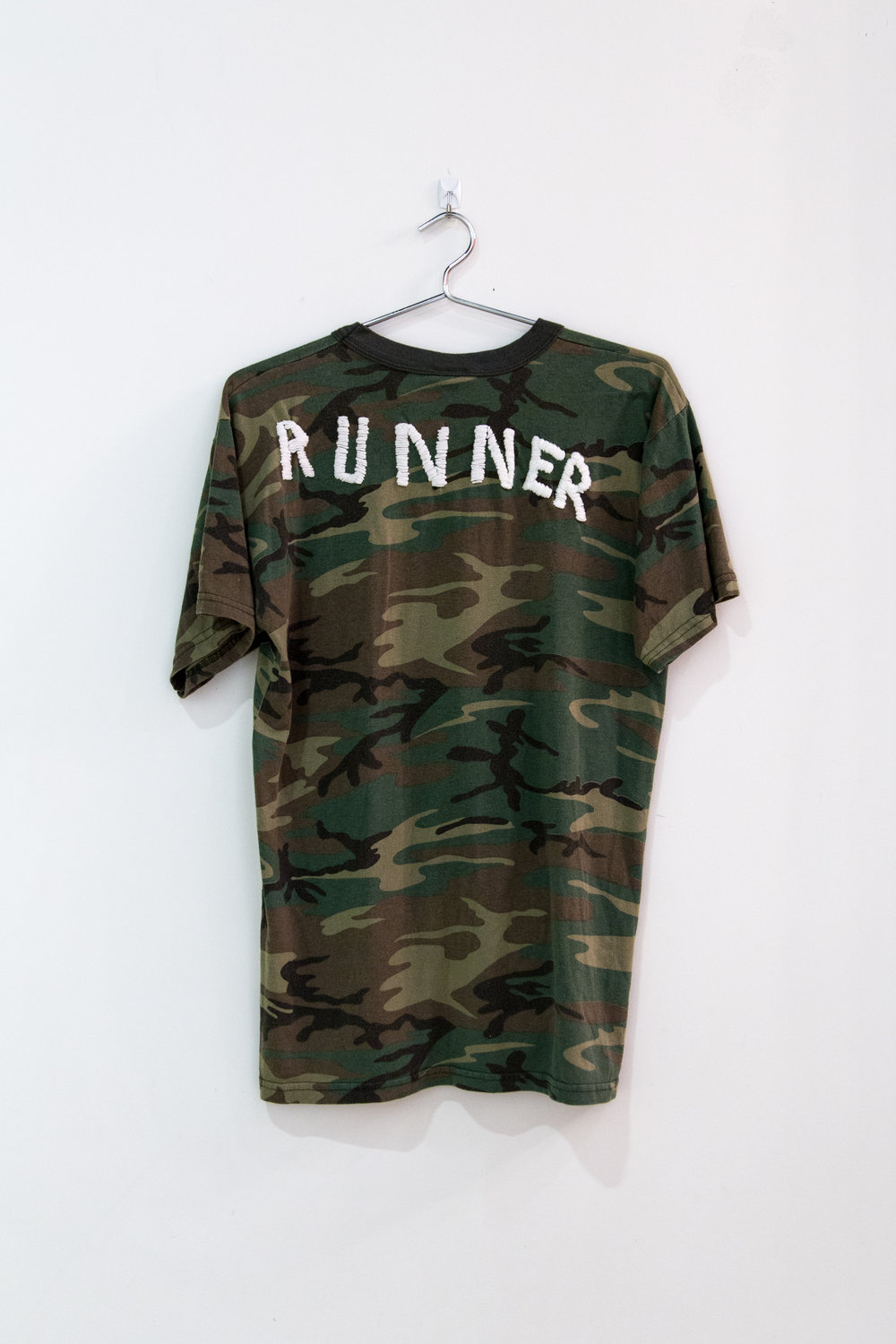 "Runner,  2017, embroidered t-shirt, 18"" x 24"""