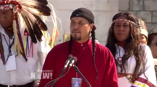 Gyasi Ross speaking at the Million Man March in D.C. Screenshot from a video by Democracy Now.