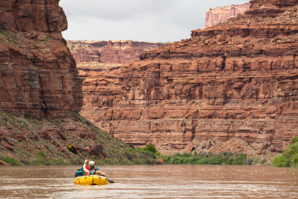 @AColoradoGal paddles among towering red rock cliff formations on the Colorado River.