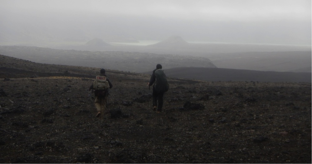 Clearing up as we cross the calderas lava flows to surprise lake barely visible in the background.