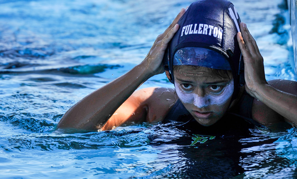 Diana Ramirez of Fullerton College puts on her game cap before the second game of Orange Empire Conference Water Polo Championships. November 3rd, 2016, 10:20am � Orange Coast College vs Saddleback College � Women�s Waterpolo � Saddleback College, Mission Viejo, CA