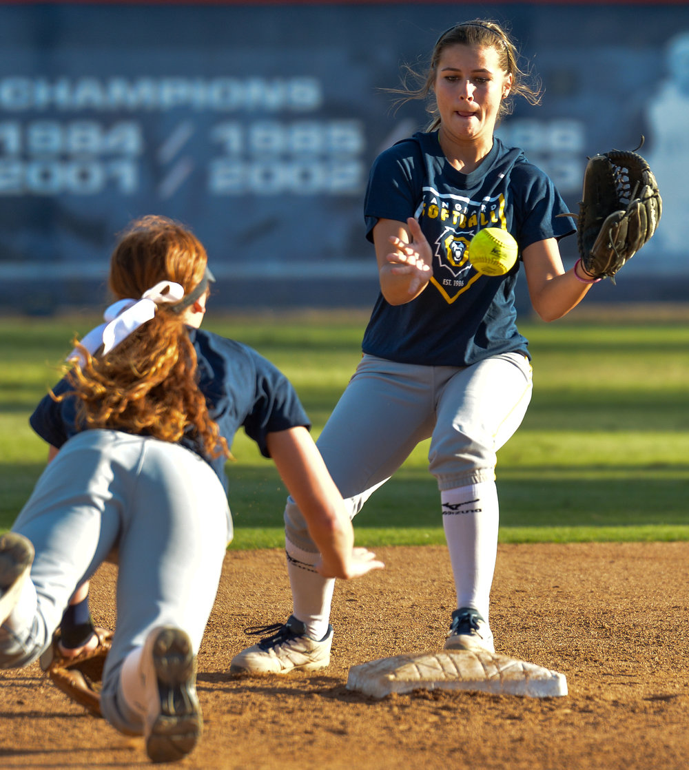 Vanguard University second basemen, Summer Penner receives the ball from her teammate to turn a double play during a game against Allan Hancock College. November 4th, 2016 — Vanguard University vs Allan Hancock College — Women's Softball — Anderson Family Field, Cal State Fullerton, Fullerton, CA