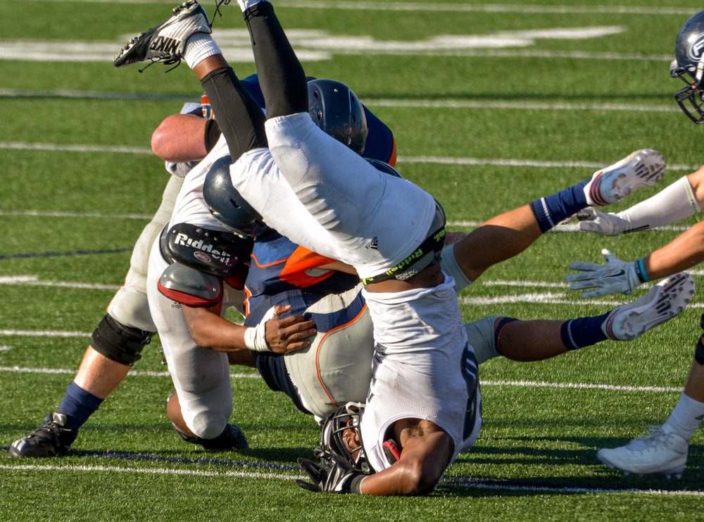 song_sat_1197- Fullerton College linebacker Tyler Stepney attempts to tackle Orange Coast College quarterback Kody Whitaker. November 5th, 2016 — Fullerton College vs Orange Coast College — Men's Football — Costa Mesa, CA