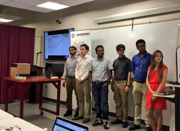 "The ""Peas Maker"" Team presenting their winning design for a pigeon pea desheller."