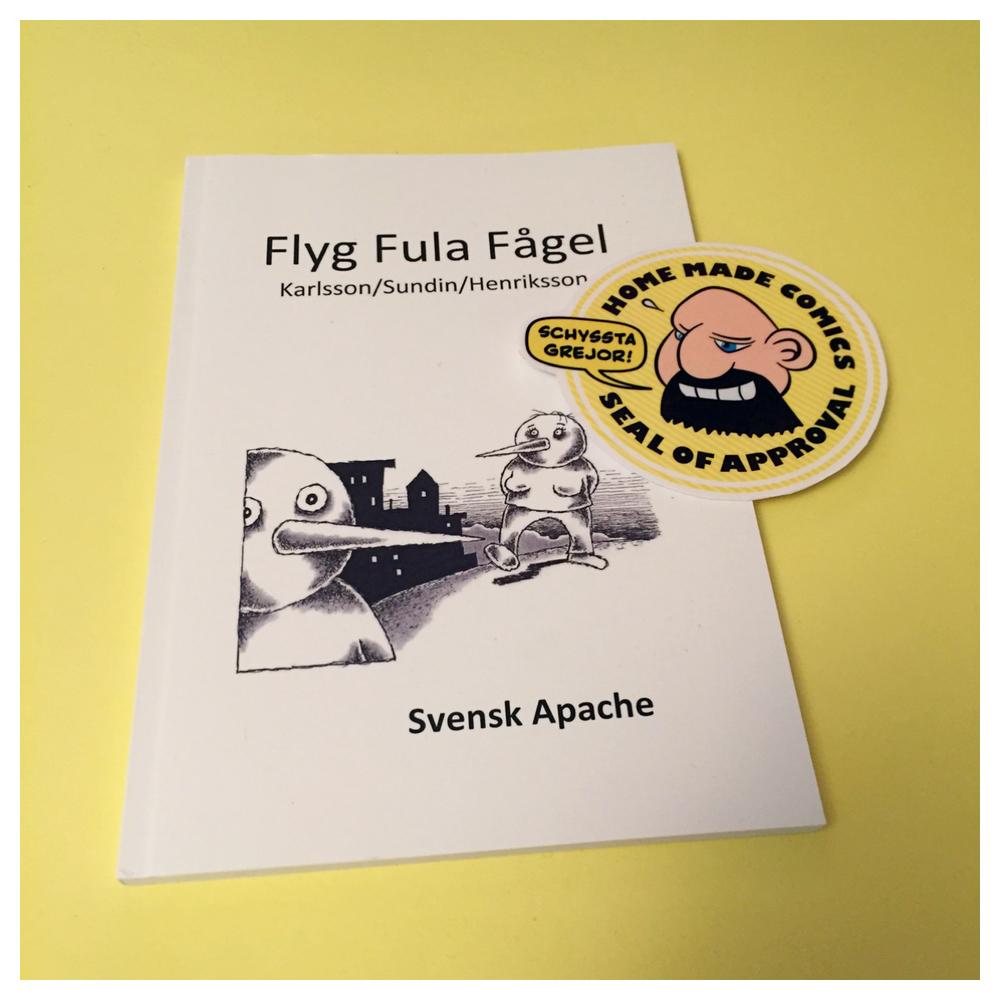 Home Made Comics Seal of Approval #135. Flyg fula fågel av Janne Karlsson, Stewe Sundin och Emma-Johanna Henriksson. Utgiven av Svensk Apache 2016.