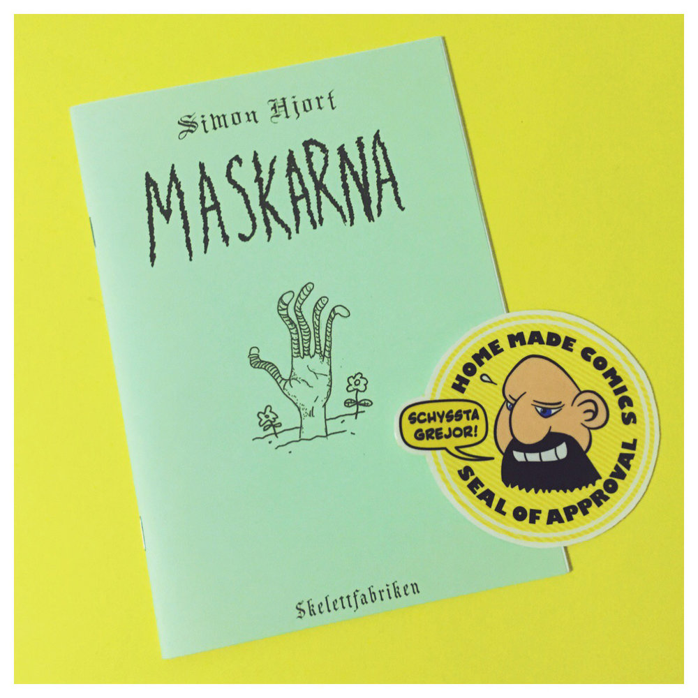 Home Made Comics Seal of Approval #156. Maskarna av Simon Hjort utgiven av Skelettfabriken 2016.