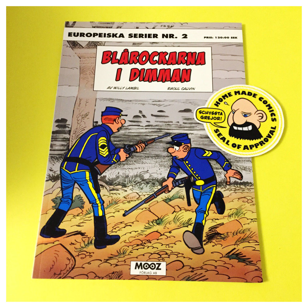 Home Made Comics Seal of Approval #181. Blårockarna i dimman av Willy Lambil och Raoul Cauvin utgiven av Mooz 2014.