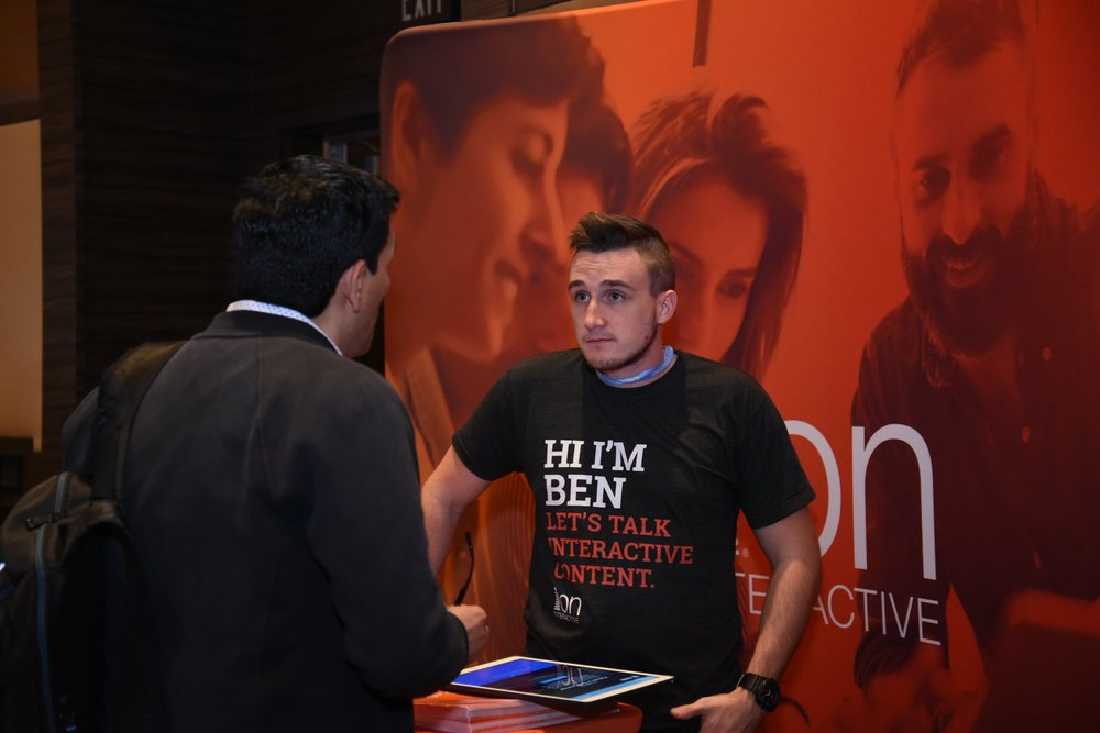 CMI snapped Benjamin manning the booth.