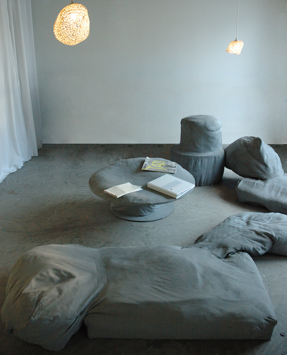 Soft furniture made with whatever Elodie found in the space + grey paint