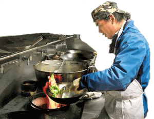 Owner Yong Lin prepares a meal in the kitchen at Jin Zhou Garden Chinese Restaurant on Berryville Pike.