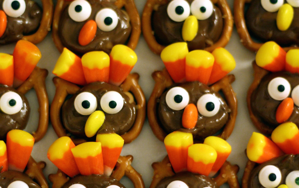 Smoosh the candy eyes into the melted Rolo then place one half of a Reeses Pieces in between each eye for the beak.