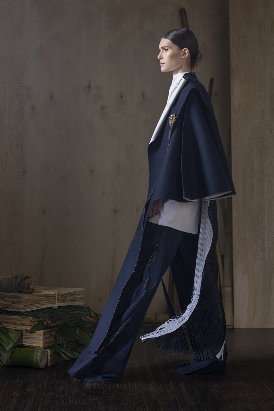 Oxford Cotton Funnel Neck Sleeveless Bouse  Paired With  Navy Double Bonded RAW Wool/Cotton Cape, Sideless Over-Vest and Navy Wool Flannel Trousers with Slitted Side Inserts.Polished, Stoned Brooch.
