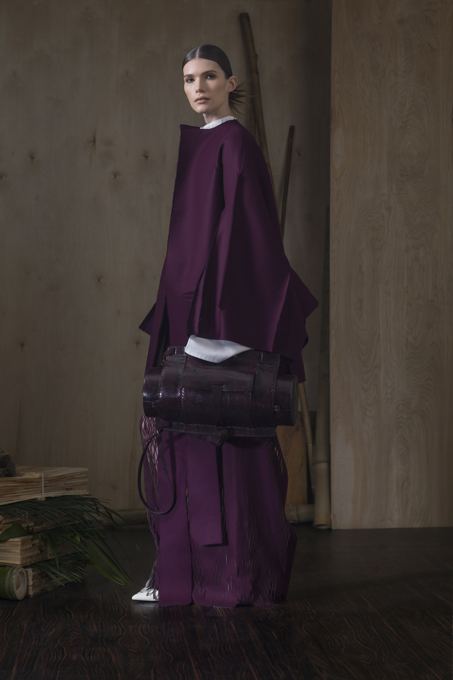Oxford Cotton Super Slitted Long SLV Blouse  Paired With  Plum Super Slitted Laser Cut RAW Skirt and Plum Double Bonded Wool Over-Coat. Plum All Python & Suede Utility Bag.