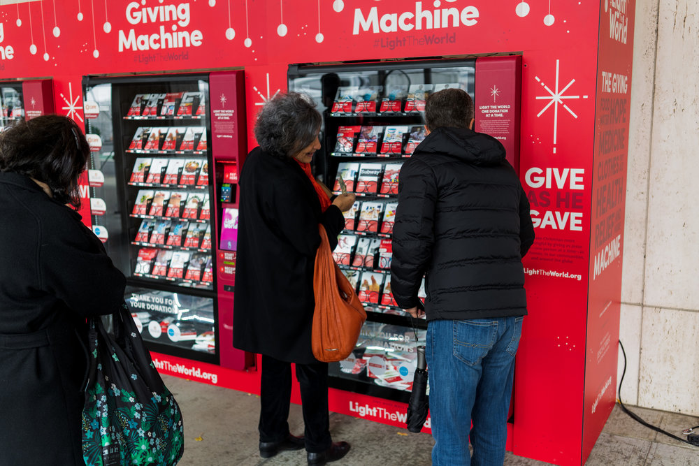 Patrons donated goods and services to those in need through vending machines in New York, Salt Lake City, London, Arizona and Manila. In some cases, people waited in line up to two hours just to give money away.