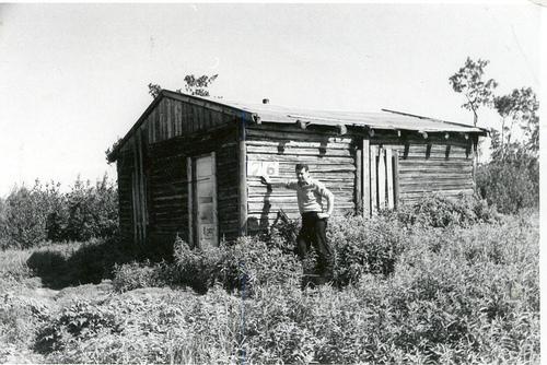 third-world-canada-man-standing-besides-house.jpg