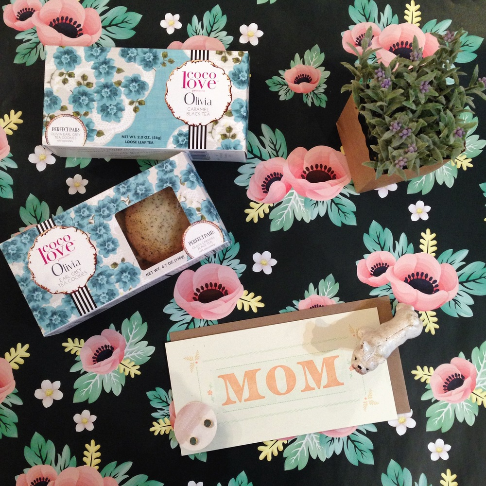 Olivia Mother's Day Gift includes: coco love Pairings Olivia Caramel Black Tea & Earl Grey Tea Cookies, Gingerly Press Card, Leslie Francesca Designs Earrings, Cast Metal Bulldog, and Faux Lavender in a Bag. Decorative paper also available at Occasionette.