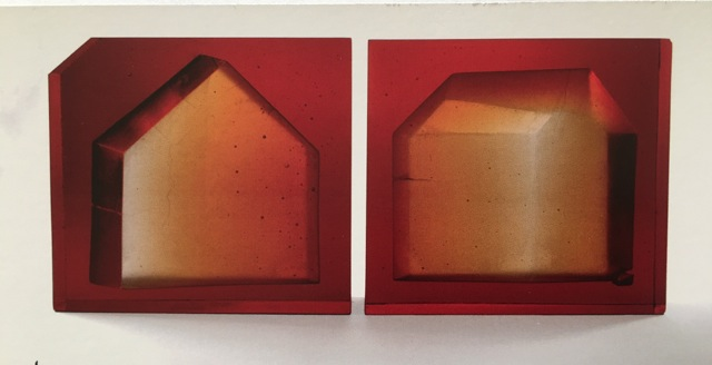 Carol Lawton. Fault Line Houses, 2005. Cast lead glass. 12 x 33 x 2.5 in.