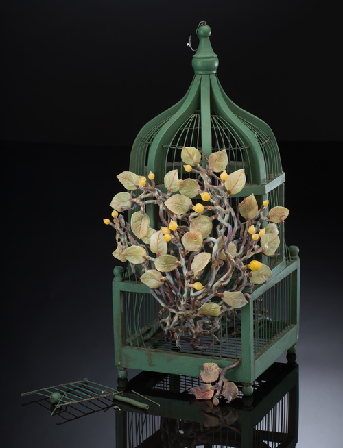 Kathleen Elliot. Liberty #1 (2015). Glass, found bird cage. 23 x 11 x 11 in.